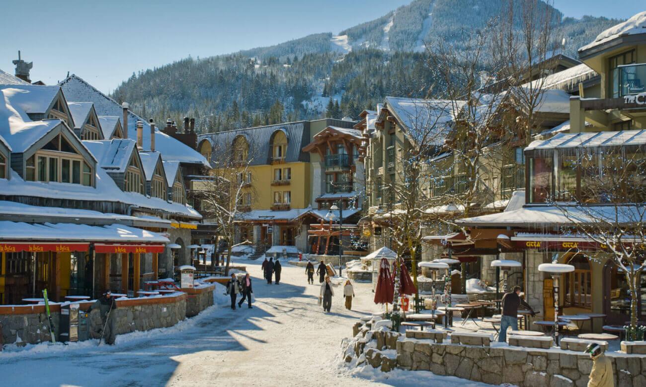 A snowy path through Whistler shops